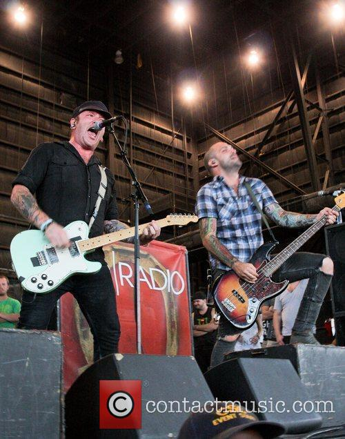 Performing at the 2011 Vans Warped Tour at...
