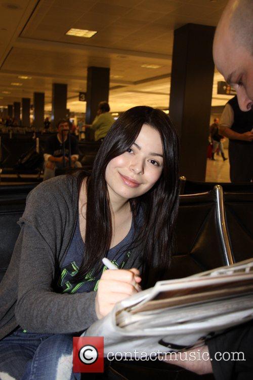 Miranda Cosgrove at Washington Dulles airport Washington DC,...