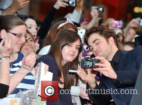 Robert Pattinson with fans UK film premiere of...