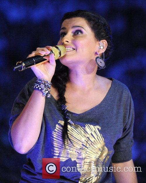 Nelly Furtado  performs on stage during 'WE...