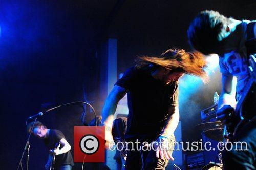Matt Welsh performing on stage for While She...