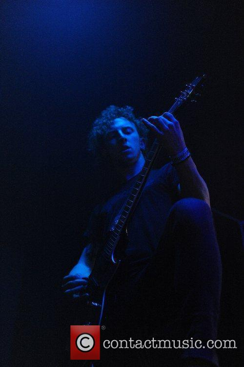 Sean Long performing on stage for While She...