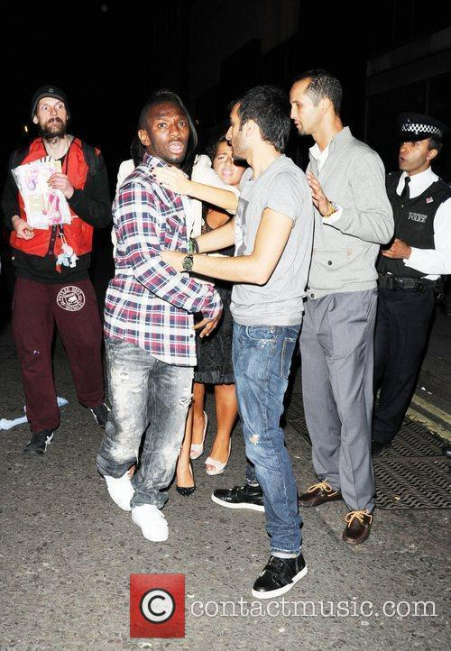 Shaun Wright-Phillips  is restrained by friends as...