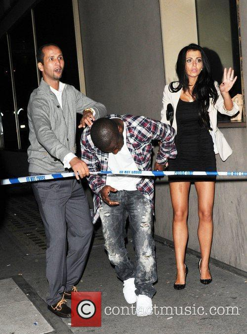 Shaun Wright-Phillips  ducking under police tape while...