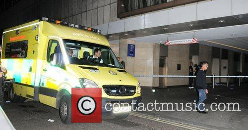 Police and an ambulance outside Whiskey Mist club...
