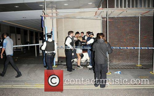 Police outside Whiskey Mist club after it was...
