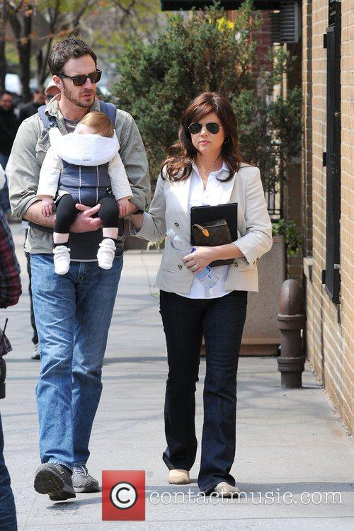 Tiffani Thiessen and husband Brady Smith with daughter...