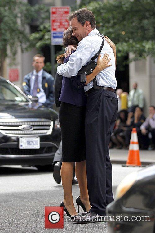 Tiffani Thiessen and Tim DeKay hugging on the...