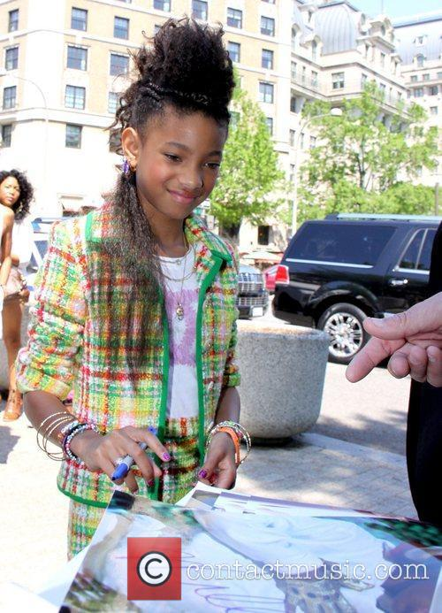 Signing an autograph as she attends the 2011...