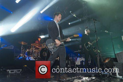 Harry McVeigh of White Lies performing at O2...