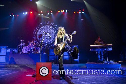Doug Aldrich performing with Whitesnake at the HMV...