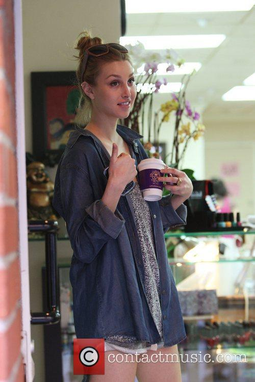 Whitney Port reality star wearing shorts as she...