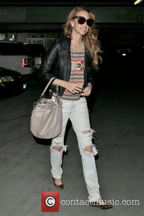 Whitney Port sporting a new reddish hair colour...