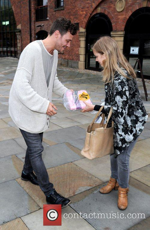 Will Young meets with a fan as he...