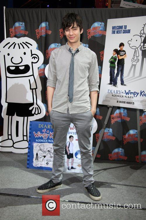 Devon Bostick Stars Of Diary Of A Wimpy Kid Rodrick Rules Visit Planet Hollywood Times Square 1 Picture Contactmusic Com