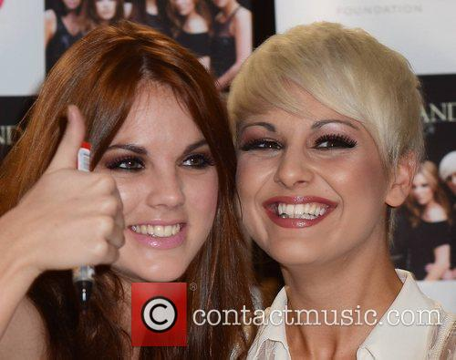 Corrina Duran, Kasey Smith Wonderland sign copies of...