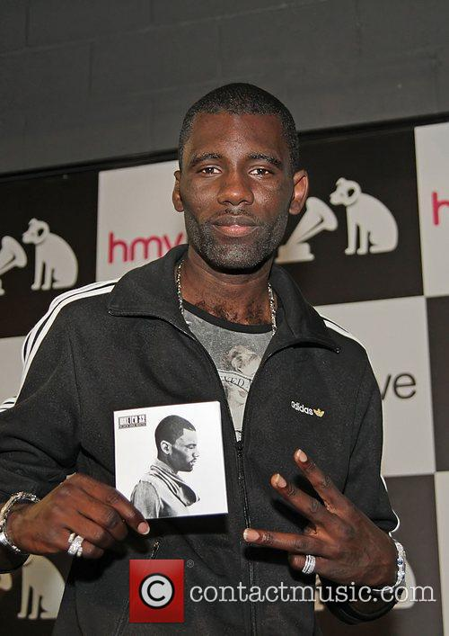 Wretch32 performing live and signing copies of his...