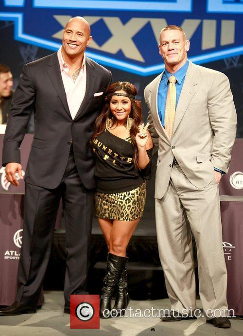 Attend a press conference with WWE superstars for...