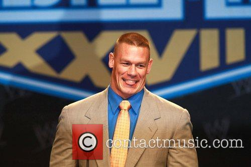 Attends a press conference with WWE superstars for...