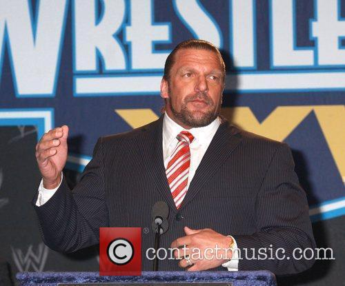 Triple H  at a press conference with...
