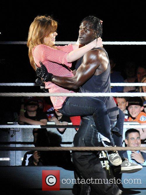 R Truth carries a fan WWE RAW Wrestling...
