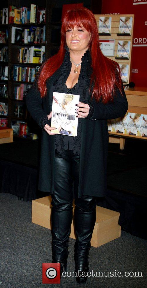Attends a signing for her new book 'Restless...