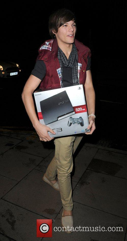 Louis Tomlinson of One Direction arrives at his...