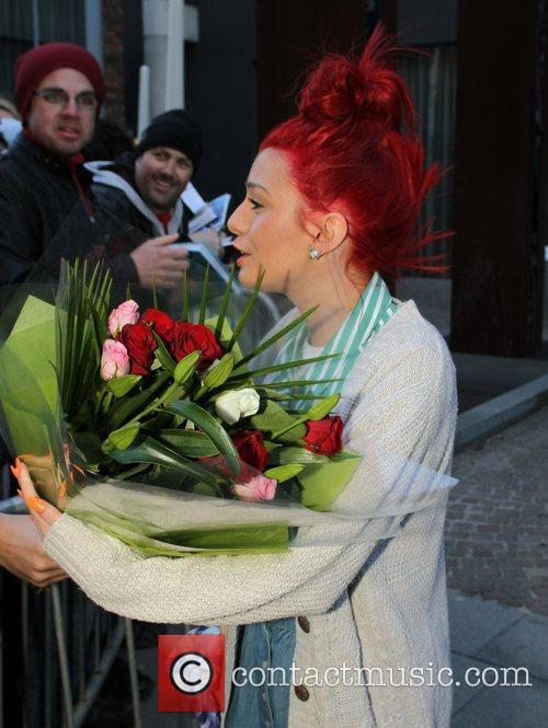 Cher Lloyd outside the hotel where the performers...