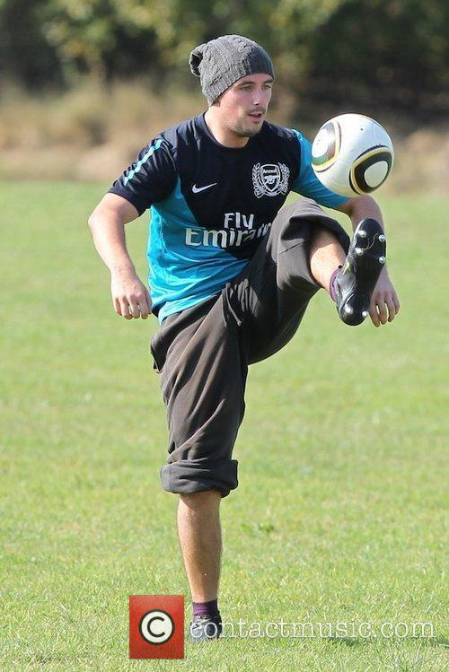 'X Factor' finalist Charlie Healy plays football outside...