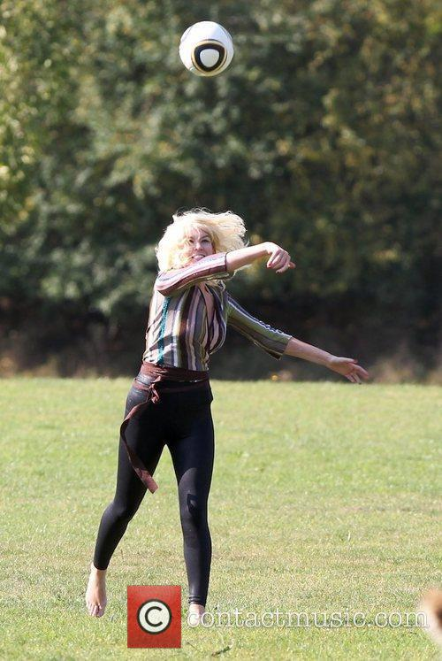 'X Factor' finalist Kitty Brucknell plays football outside...