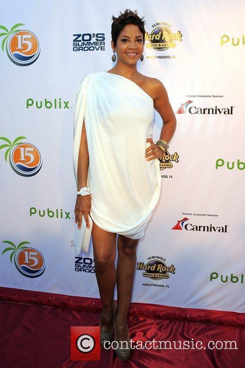 Tracy Mourning arrives at Zo Summer Groove Benefit...