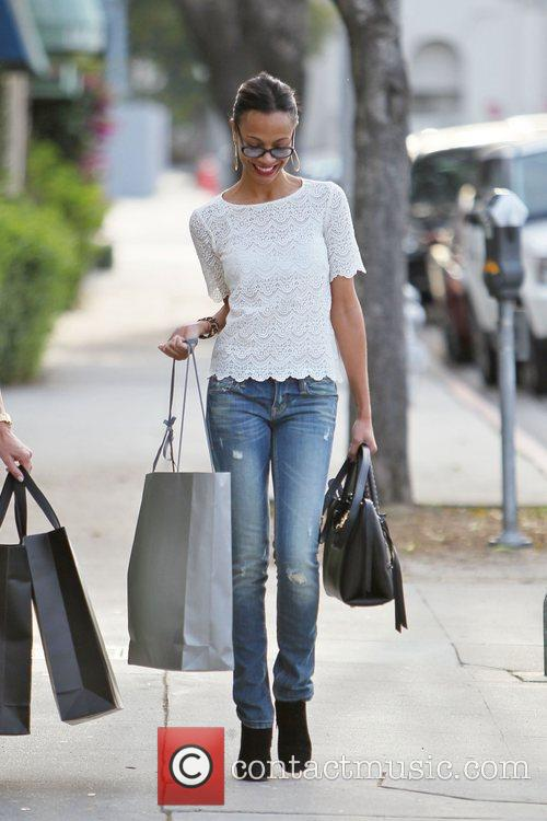 Zoe Saldana seen leaving an office building carrying...