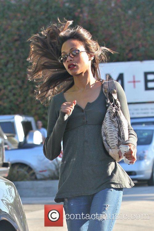 Zoe Saldana runs to her car after leaving...
