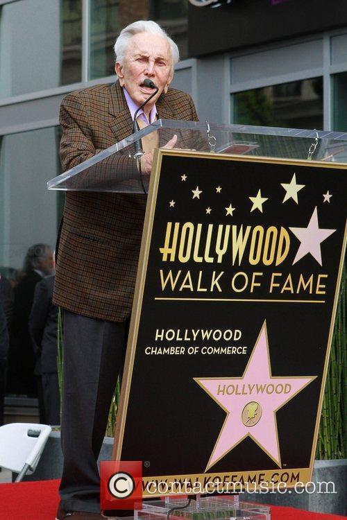 Kirk Douglas speaking Maestro Zubin Mehta receives a...