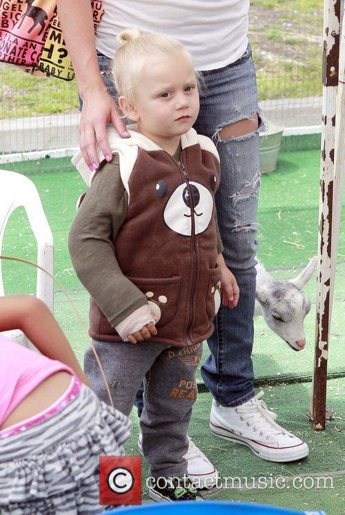 Two-year-old Zuma Rossdale visits a petting zoo and...