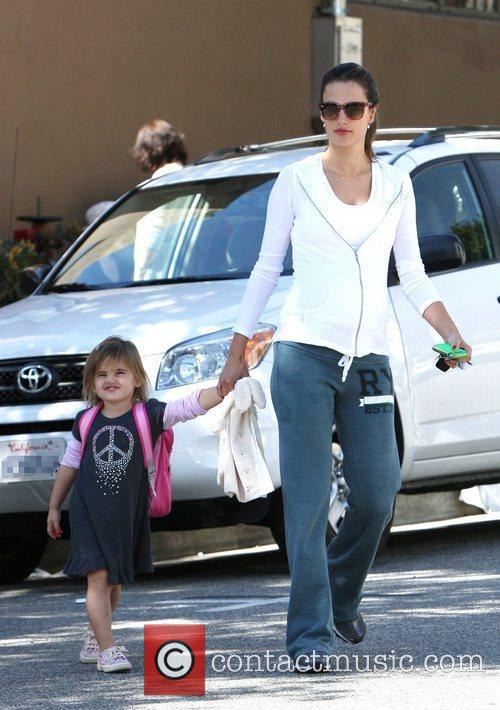 Picking her daughter Anja up from school in...