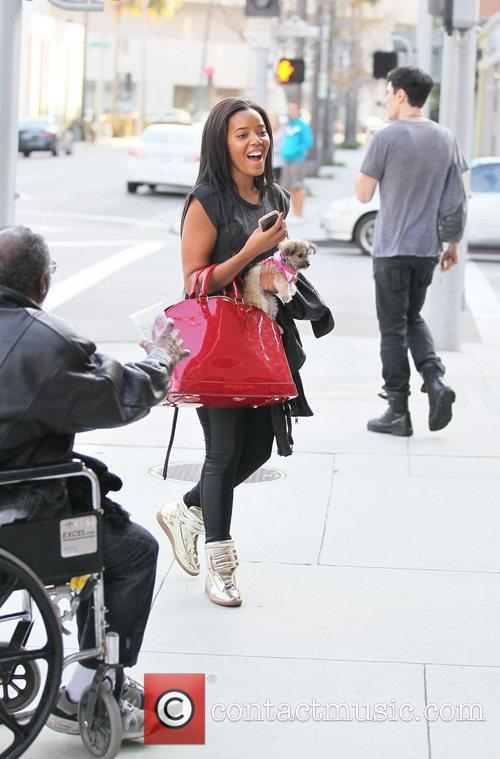 Angela Simmons is approached by a beggar after...
