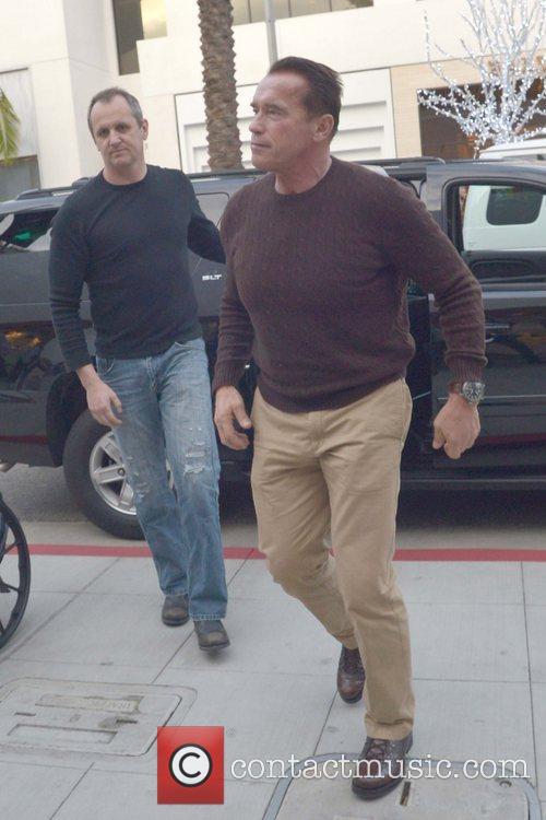 Arnold Schwarzenegger heads to Prada on Christmas Eve...