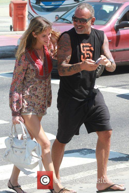 French fashion designer Christian Audigier and his girlfriend...