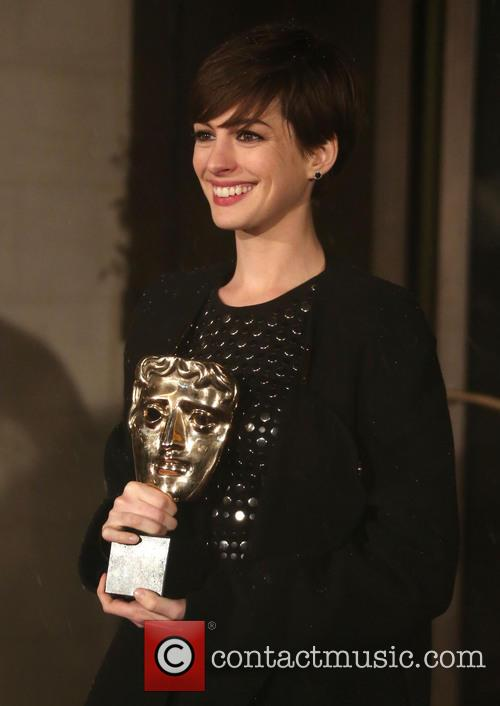 Anne Hathaway Clutches Her BAFTA for Les Miserables