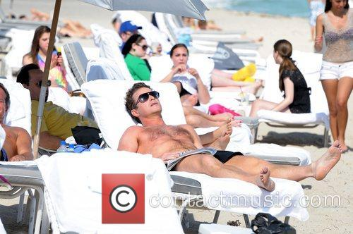Working on his tan at Miami Beach