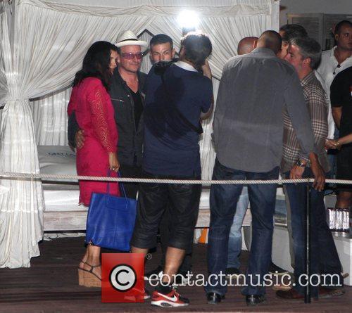 Bono attends Dj Luciano's Vagabundos open air party...
