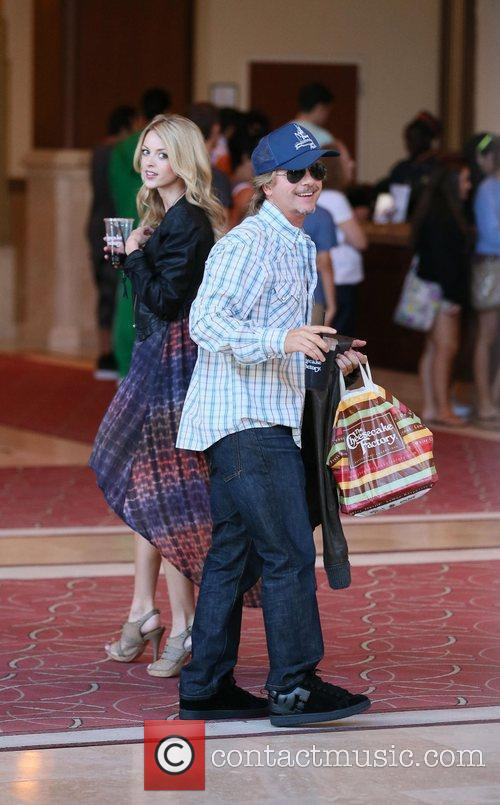 David Spade and his girlfriend Jillian Grace go...