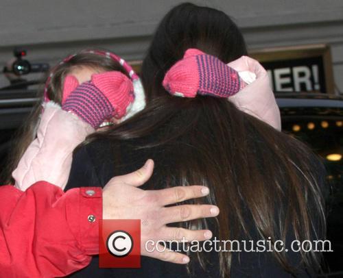 Katie Holmes; Suri Cruise Katie Holmes carries her...