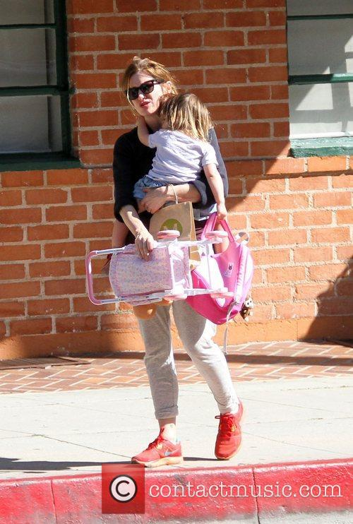 Katherin Hahn leaves a medical office with her...