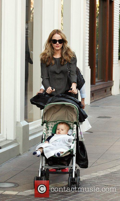 Pushing her son Luciano in a stroller
