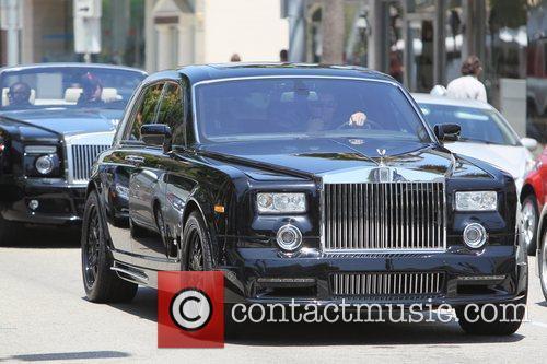 Seen driving his Rolls Royce Phantom convertible, through...
