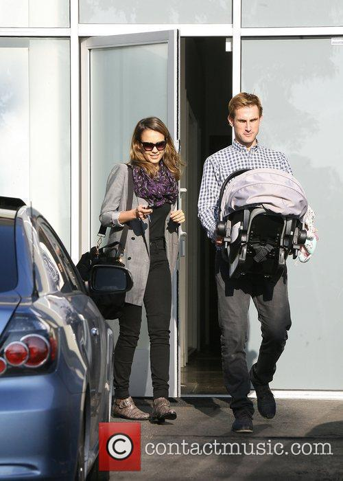 Jessica Alba gets some help carrying her car...