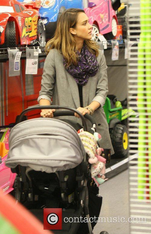 Jessica Alba shopping at Toys R US pushing...