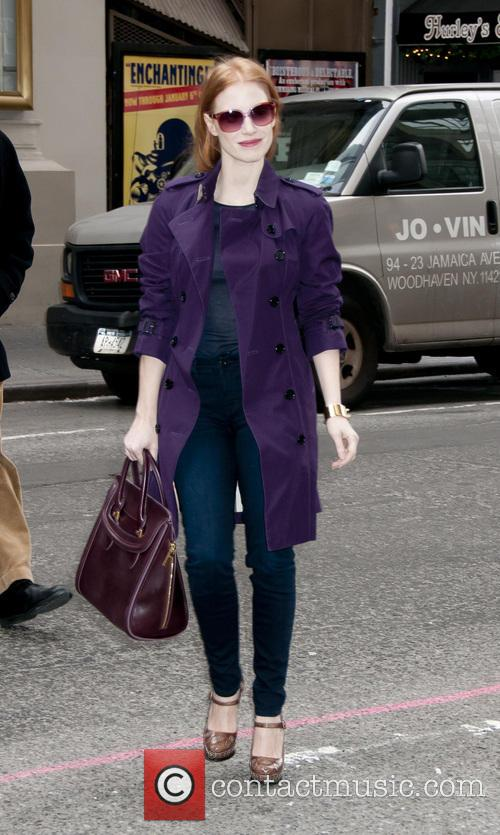 Jessica Chastain Jessica Chastain wears a purple trench...